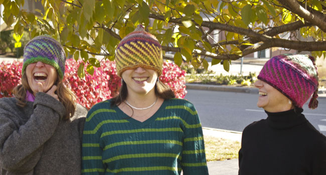 halcyon yarn staff with hats pulled over eyes - don't let us pull the woll over our eyes, contact us!