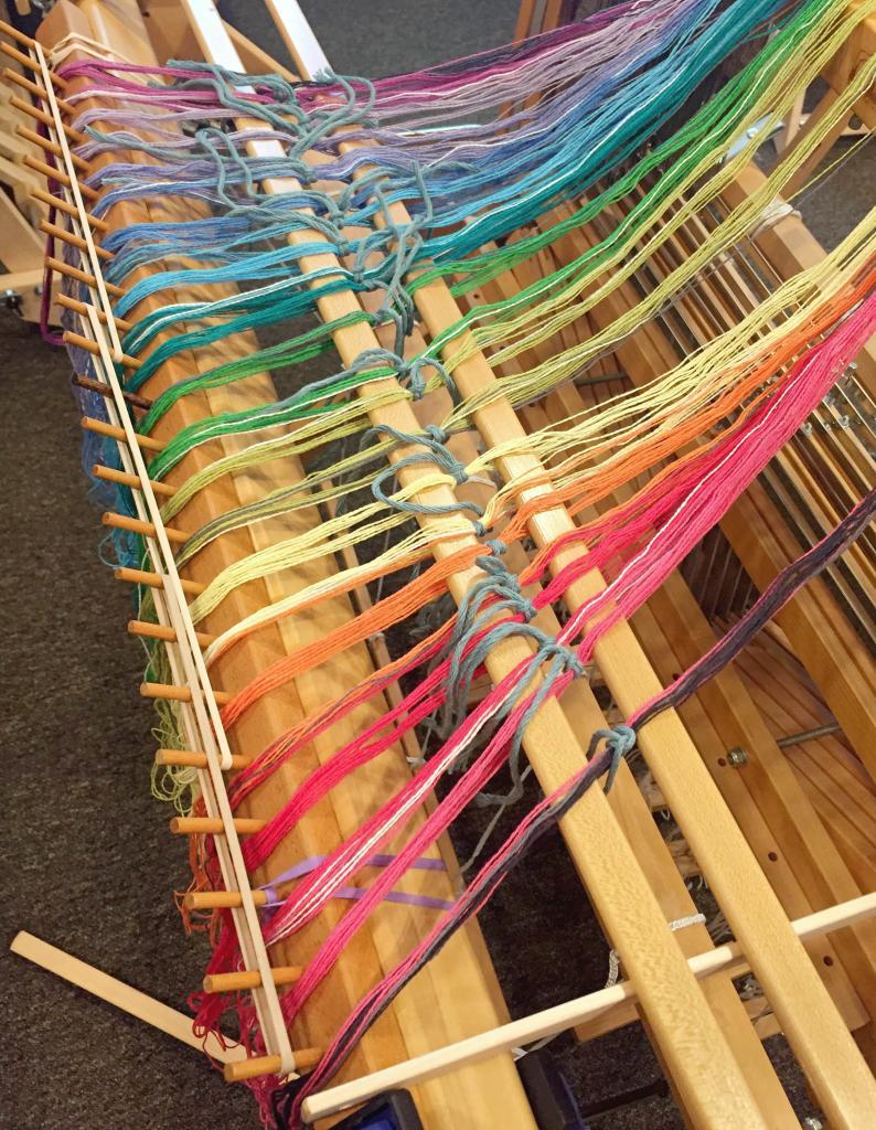 warping the homestead gamp on the loom